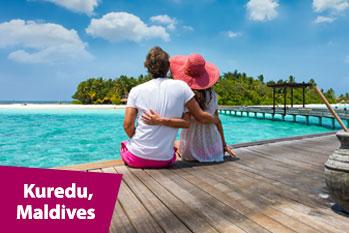 Couple on a pathway of luxury resort Maldives